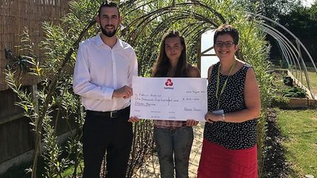 Stuart Gollands from the Black Swan Care Group presents a cheque to Katie Fullilove and Clare Peak o