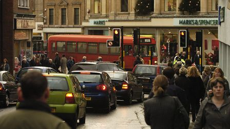 Traffic and pedestrians on Westlegate in Norwich just over a week before Christmas 2004.Picture: Jam