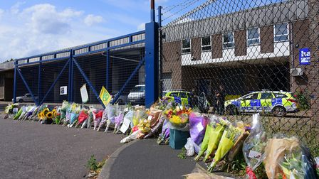 Floral tributes to Daniel Timbers and Barry Joy at the Harford Attachments factory on Spar Road, Nor