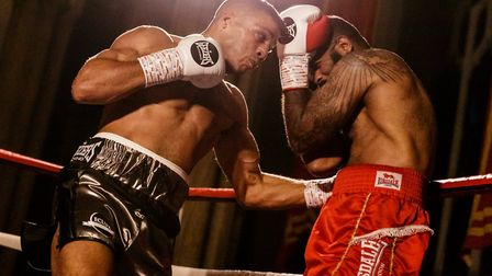 Iain Martell lands the body shot that ended his fight against Adam Williams Picture: Mark Hewlett