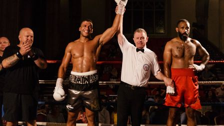 Iain Martell's hands in rased in victory by referee Lee Cook Picture: Mark Hewlett