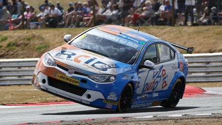 Rory Butcher two wheeling his MG6 around Nelson during the BTCC meeting at Snetterton Picture: Jakob