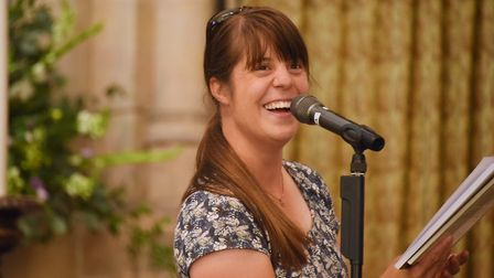 Diana Rackham, chairman of the Friends of the Norfolk Dialect, reads poetry at Norwich Cathedral for