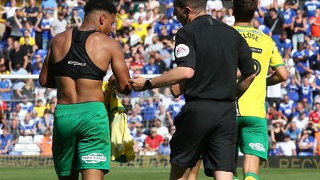 Onel Hernandez is booked for removing his shirt, in celebration of his first Norwich City goal - and