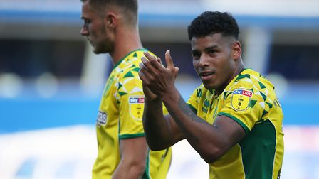 Onel Hernandez applauds the traveling Norwich City support. The man behind him, Dennis Srbeny, playe
