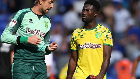 Debutant Tim Krul (left) has a chat with Canaries veteran Alex Tettey, following Norwich City's 2-2