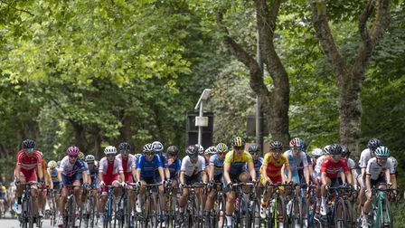 Sophie Wright, second from left in the pink helmet, eventually got swallowed up by the peloton after