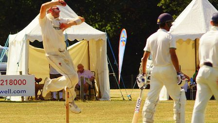 Skipper Chris Brown in full flight for Norfolk at a sun-drenched Manor Park yesterday Picture: TIM F
