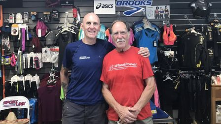 Sportlink owner Neil Featherby with North Norfolk Beach Runner Robin Rush. Picture: Neil Featherby