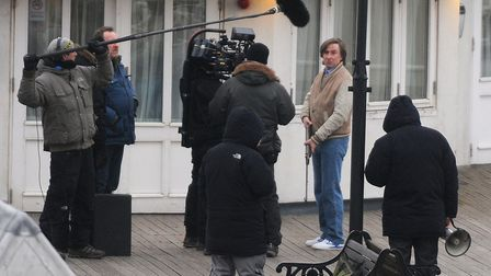Filming of Alan Partridge, The Movie at Cromer Pier. Actor, Steve Coogan shooting a scene holding a