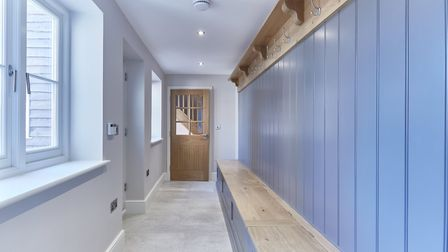 Behind the secret door; the utility with pegs. Pic: www.savills.co.uk