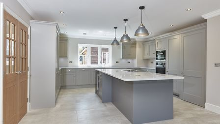 The kitchen at Mallards with the secret door, right. Pic: www.savills.co.uk