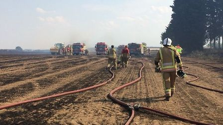 Norfolk Fire and Rescue Service at the scene of a field fire in Ringstead. Picture: Rebecca Murphy