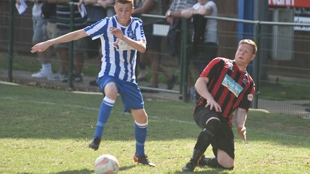 Wroxham's Sonny Carey tries to plot a way through the Saffron Walden defence. Picture: Sonya Duncan