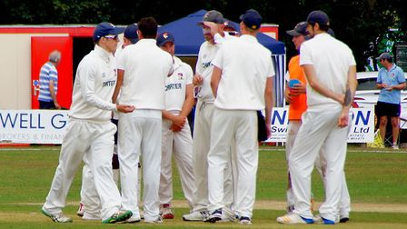 Chris Brown is congratulated by his Norfolk colleagues after moving second in the county's all-time