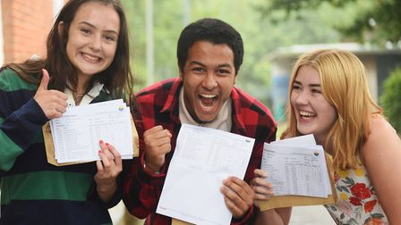 Mohammad Ali, 17, celebrates getting four A* with fellow medical students, Jess Scarlett, 17, left,