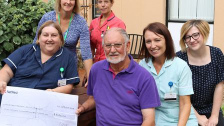 Gavin English presents his latest donation for QEH cancer care and treatment. Picture: Courtesy of t