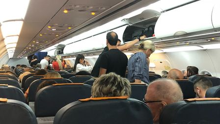 Passengers waiting on board the Norwich Airport flight to Dalaman after it landed at Brussels Airpor