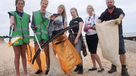 Volunteers at work clearing rubbish and litter from the North Denes dunes and beach at Lowestoft as