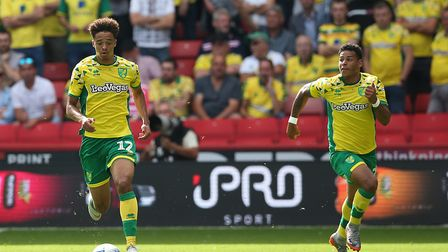 Jamal Lewis of Norwich and Onel Hernandez of Norwich break out of defence during the Sky Bet Champio