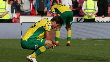 Timm Klose of Norwich and Grant Hanley of Norwich look dejected at the end of the Sky Bet Championsh