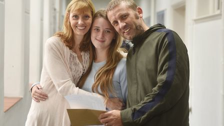 A-Level results day at King Edward VII Academy in King's Lynn. Chloe Watson with her parents Catheri