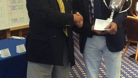 Norfolk seniors champion Gary Harvey (right) receives his trophy for county president Mike Turner Pi