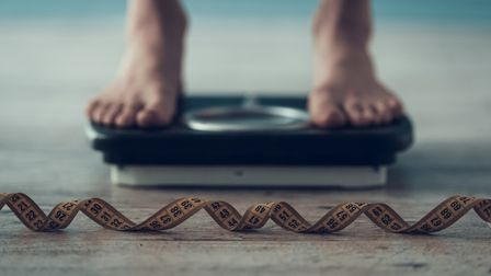 Stock photo of a person weighing themselves. Photo: Getty