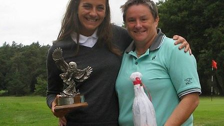 Jess Dixon (left) regained Thetford Golf Clubs Ladies Club Championship trophy with victory over def
