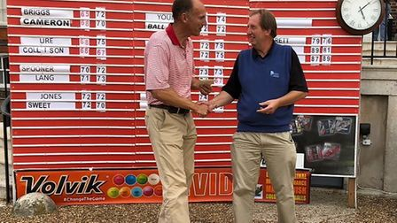 Bungay & Waveney Valley's Andrew Collison receives his cheque at Richmond Golf Club from Masters Pro