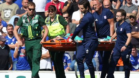 Cole Skuse of Ipswich Town leaves the match on a stretcher during the Sky Bet Championship match at