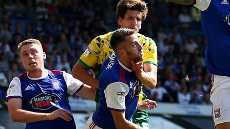 Ipswich Town's Cole Skuse (front) collides with Norwich City's Timm Klose during the Sky Bet Champio