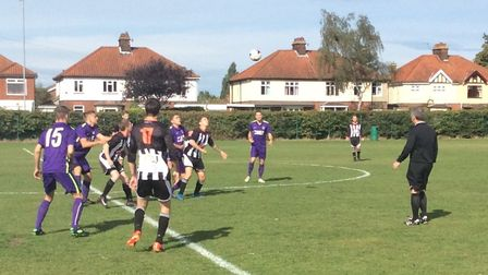 Action from the Division One game between Mischief (purple) and Aslacton & Gt Moulton Picture: Steve