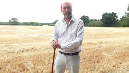 Breckland district councillor, Bill Borrett, at the site of the proposed development of ten thousand
