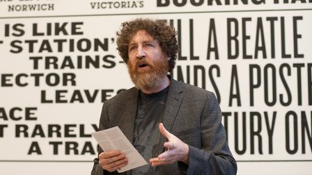 Poet Ira Lightman at the poetry wall at Pablo Fanque House. Pic: Martin Gray.