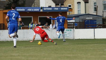 Lowestoft's Adam Smith is judged to have fouled Tamworth's Chris Lait Picture: Shirley D Whitlow