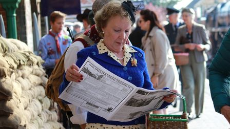 Reading the 1940s Gazette, published by the North Norfolk Railway especially for the annual event.Ph