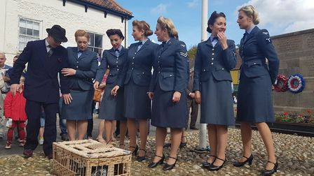 Britain's Got Talent stars the D-Day Darlings releasing the birds for Holt's 1940s weekend pigeon ra