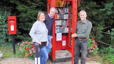 Jo Billham, Keith Morris and Andrew Moore with the new Swap Box in Wreningham. Picture: Courtesy of