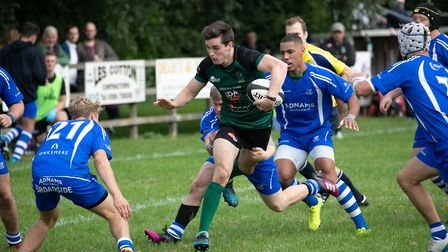 Matt Hodgson is surrounded by Diss opponents at Mackenders Picture: HYWEL JONES