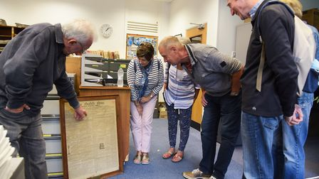 Selwyn Taylor, left, takes a tour around Archant's library for the Heritage Open Days. Picture: DENI