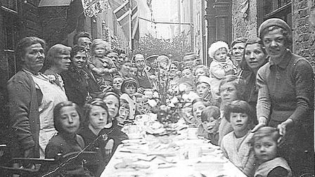 Party time in a Great Yarmouth row to celebrate the end of the war in 1945. Picture: ARTHUR BENSLEY