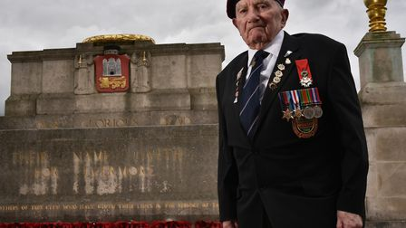Len Mann by the War Memorial in Norwich. Mr Mann is calling for the council to clean and maintain th