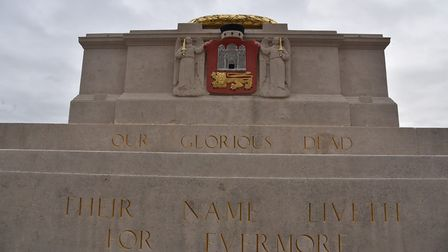 Norwich War Memorial has been cleaned up.Standing by the memorial are members of the council and the