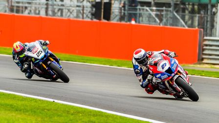 RAF Regular & Reserves Jake Dixon leads Josh Brookes out of Woodcote. Picture: Barry Clay