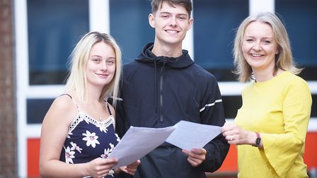 GCSE results day at the Downham Market Academy. Pictured with Liz Truss MP are Charlie Williams and