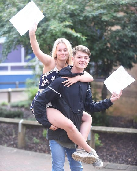 GCSE results day at the Downham Market Academy. Pictured are Charlie Williams and Rosie Hunt. Pictur