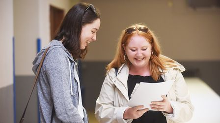GCSE results day at Downham Market Academy. Pictured are (L) Chloe and Maddie Hobday. Picture: Ian B