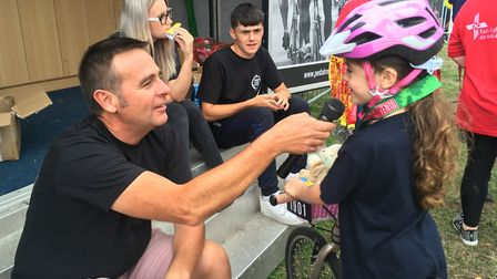 Thalia was delighted to tell the finish line commentator all about her 25 mile ride. Picture contrib