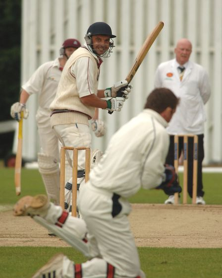 Swardeston's Barney Goodrum looks behind to see if he is caught - and the smile stayed on his face a